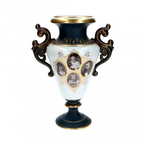 Vase in the style of an amphora with eight portrait photographs